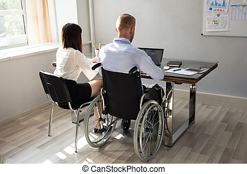 Disabled Businessman Working On Laptop