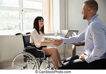 Disabled Businesswoman Shaking Hand With Her Partner