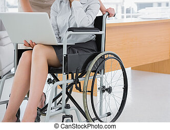 Disabled businesswoman showing lapt