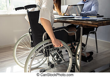 Disabled Businesswoman Sitting On Wheelchair