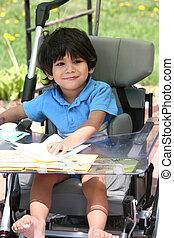 Disabled child in medical stroller - Disabled little boy in...