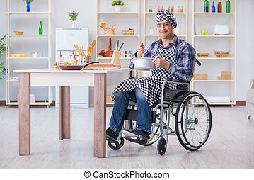 Disabled cook on wheelchair in cooking concept