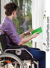 Disabled during free time - Vertical view of a disabled man...