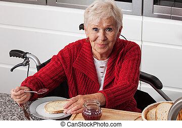 Disabled elderly in kitchen
