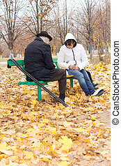 Disabled elderly man and woman playing chess