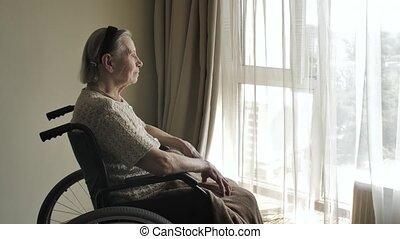 Disabled elderly woman on wheelchair