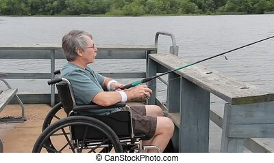Disabled fisherman on a dock - Disabled fisherman on a...