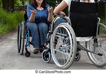 Disabled girls during conversation