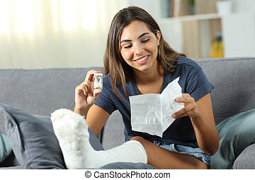 Disabled happy woman reading leaflet at home