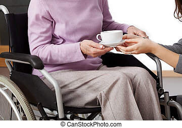 Disabled help - Granddaughter helping disabled grandmother