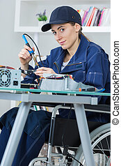 Disabled lady soldering