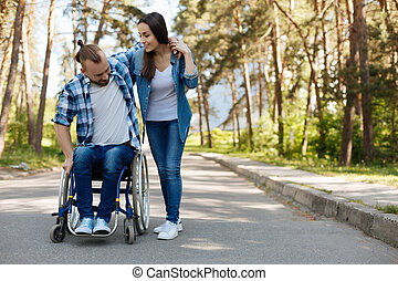 Disabled male person trying to stand up - I will help you....