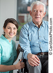 Disabled man and social welfare worker - Image of disabled...
