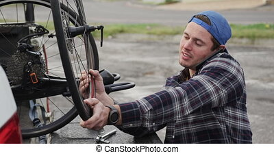 Disabled man assembling parts of a bicycle