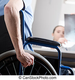 Disabled man at doctors office