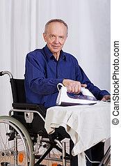 Disabled man during ironing