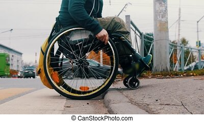 Disabled man in wheelchair makes attempt to climb a step - another people help him. Mid shot