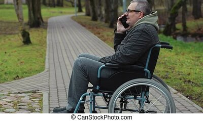 Disabled man in wheelchair on path
