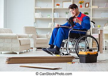 Disabled man laying floor laminate in office