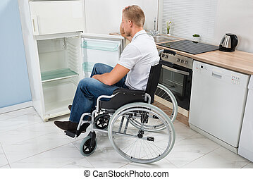 Disabled Man Look Into A Refrigerator - Disabled Man On...