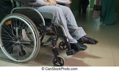 Disabled man on a wheelchair standing inside hospital or...