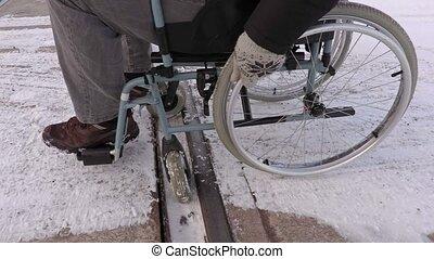 Disabled man on wheelchair stuck on railway