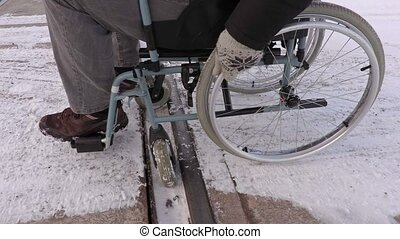 Disabled man on wheelchair stuck on railway