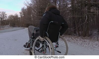 Disabled man on wheelchair try to cross highway