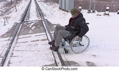 Disabled man on wheelchair try to cross railway crossing