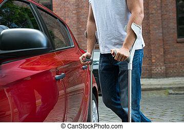Disabled Man Opening Door Of A Car