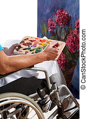 Disabled man painting picture