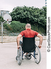 disabled man playing basketball on the court