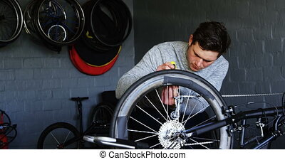 Disabled man repairing wheelchair at workshop 4k - Young...