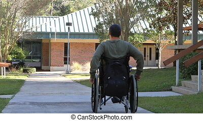 Disabled Man Rolling Away - Disabled veteran student goes...