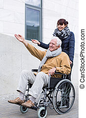 Disabled man spending time outdoors - Disabled man and his...