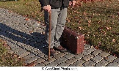 Disabled man take suitcase