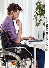 Disabled man using a laptop