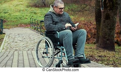 Disabled man using tablet PC