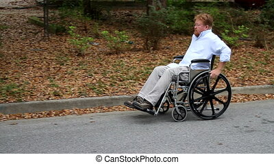 Disabled Man Using Wheelchair Pan