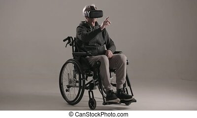 Disabled man wearing virtual reality glasses - Disabled Man...