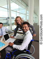 Disabled man with colleagues