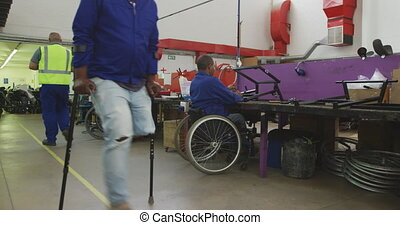 Disabled men at work - Side view of two disabled African ...