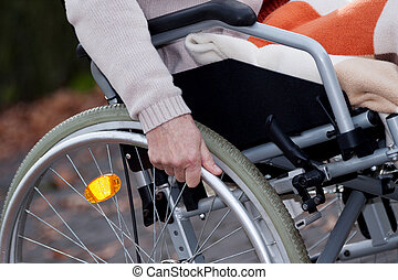 Disabled moving - Disabled old woman moving on wheelchair