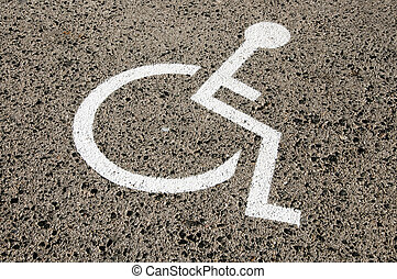 Disabled parking permit sign painted on the street