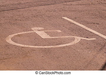 Disabled parking permit sign painted on the street.