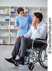Disabled patient on wheelchair visiting doctor for regular...