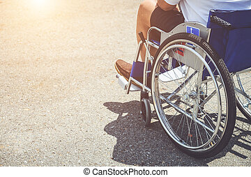 Disabled people sitting on the wheelchair in the park