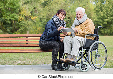 Disabled retiree in park
