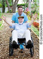 Disabled Senior - Fun - Caring nursing home orderly pops a...