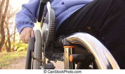 senior hand turning wheelchair - Disabled senior hand...